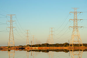 High Voltage Power lit by dawn light, with a r...