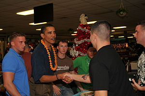 President-elect Barack Obama shakes a Marine's...