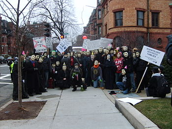 Anonmyous protestors pose for group picture.JPG