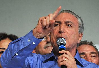 Português do Brasil: Michel Temer durante a co...