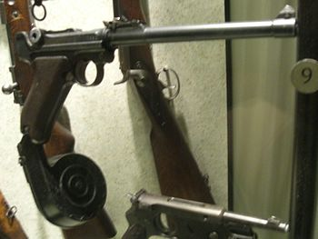 English: A Luger P08 pistol with long barrel a...