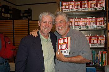 English: Activist and author Tom Hayden (left)...