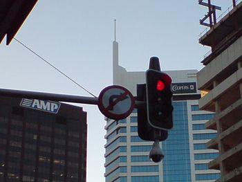 English: A surveillance camera at a traffic li...