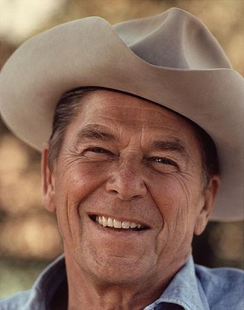 Ronald Reagan wearing cowboy hat at Rancho del...