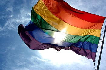 English: Rainbow flag flapping in the wind wit...